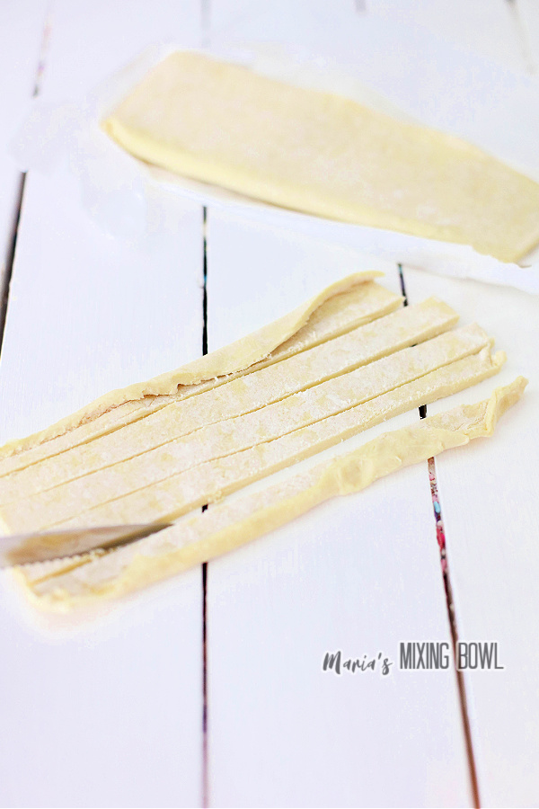 Pastry dough cut into strips.