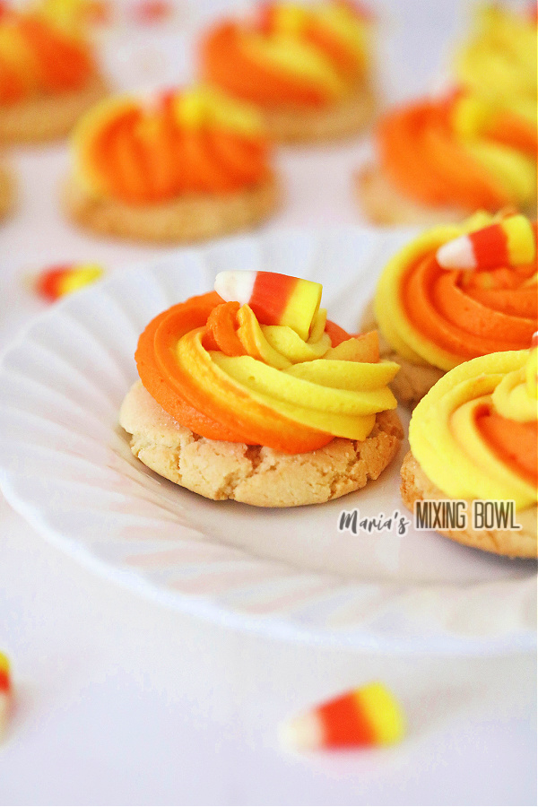 Closeup shot of candy corn sugar cookies on white plate