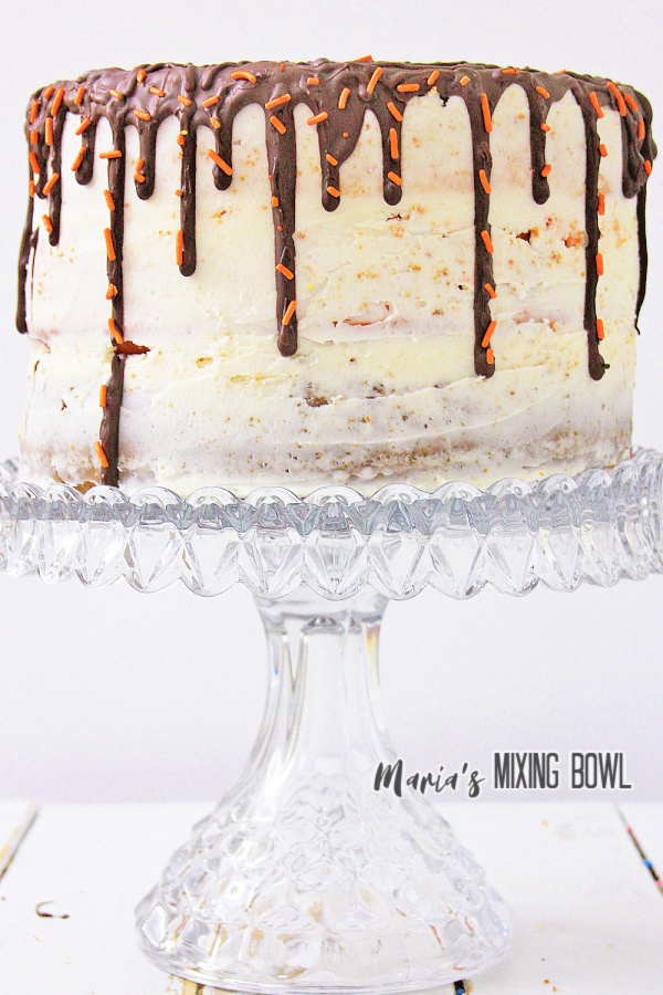 Frosted pumpkin spice latte cake on cake stand