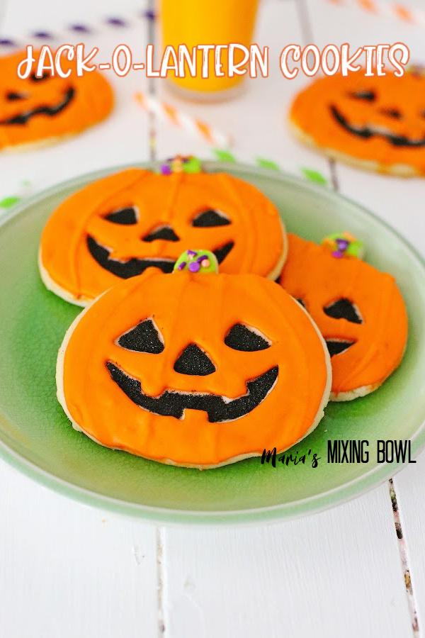 Jack-o-lantern cookies on green plate