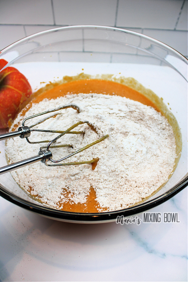 Mixing bowl filled with pumpkin puree and flour