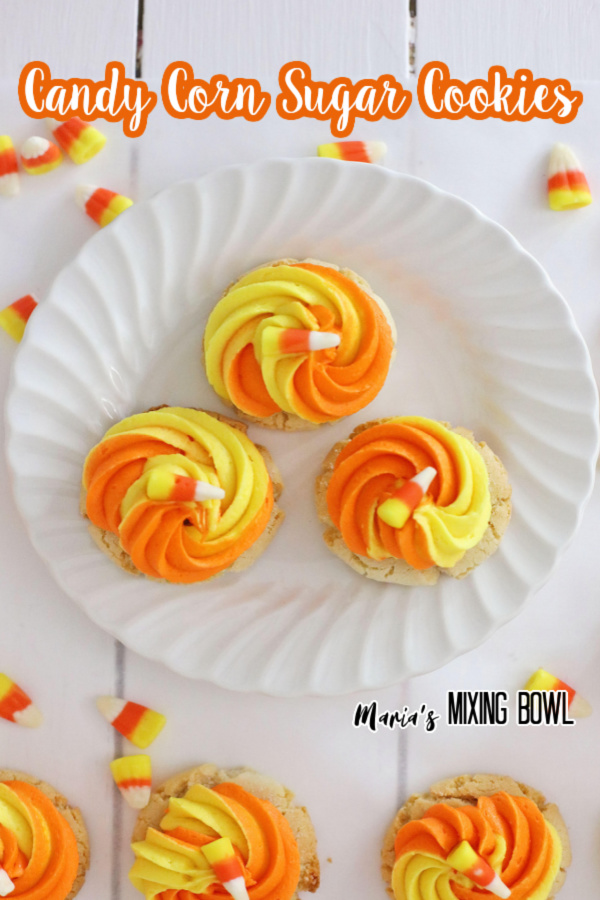 Overhead shot of candy corn cookies on white plate