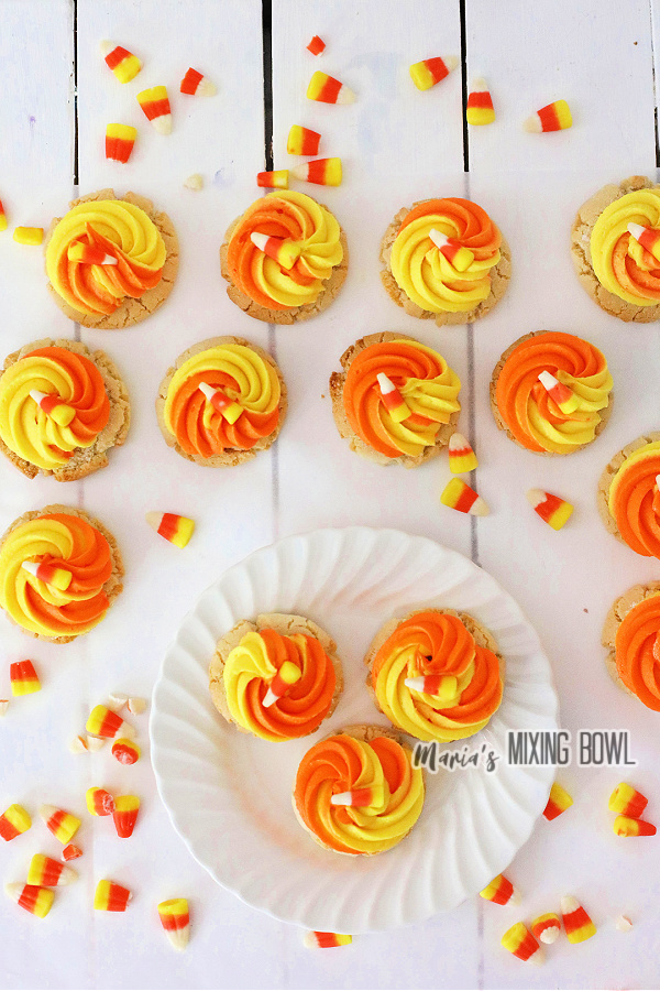 Overhead shot of yellow and orange frosted cookies