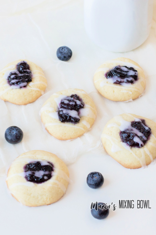 blueberry thumbprint cookies with blueberries and glaze