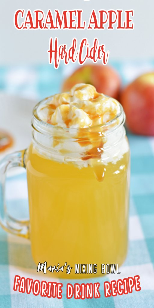 Closeup of caramel apple hard cider topped with whipped cream and caramel sauce.