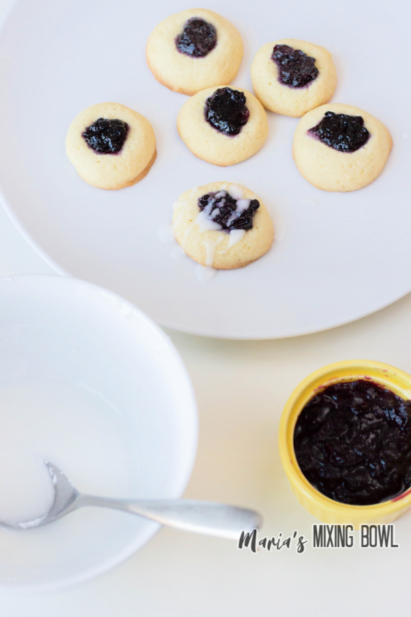 cookies on white plate with jam