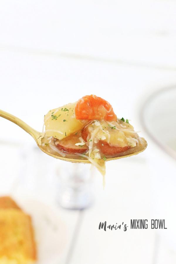 Closeup shot of spoonful of kielbasa potato soup