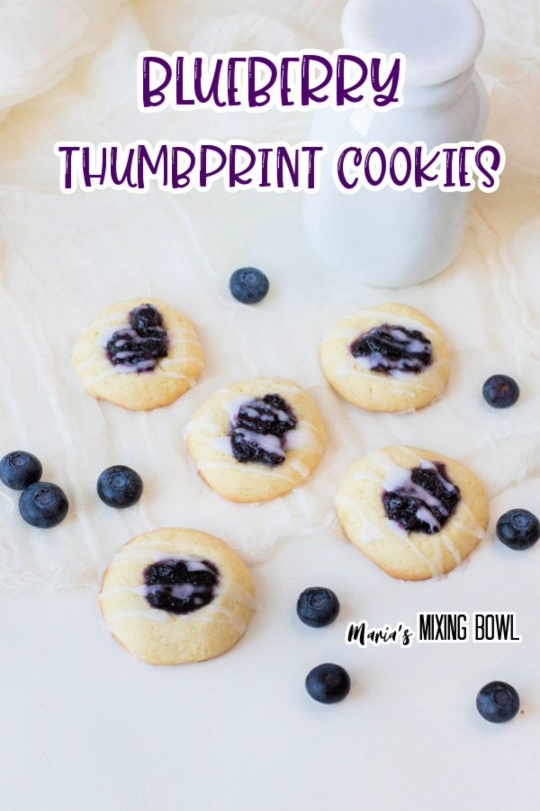 cookies on white board with blueberries