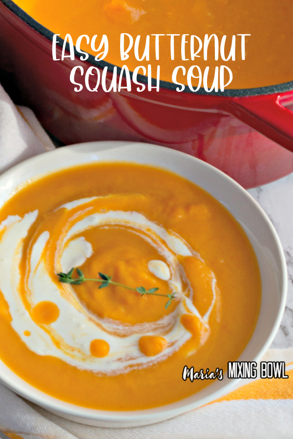 Bowl full of easy butternut squash soup next to pot of more soup