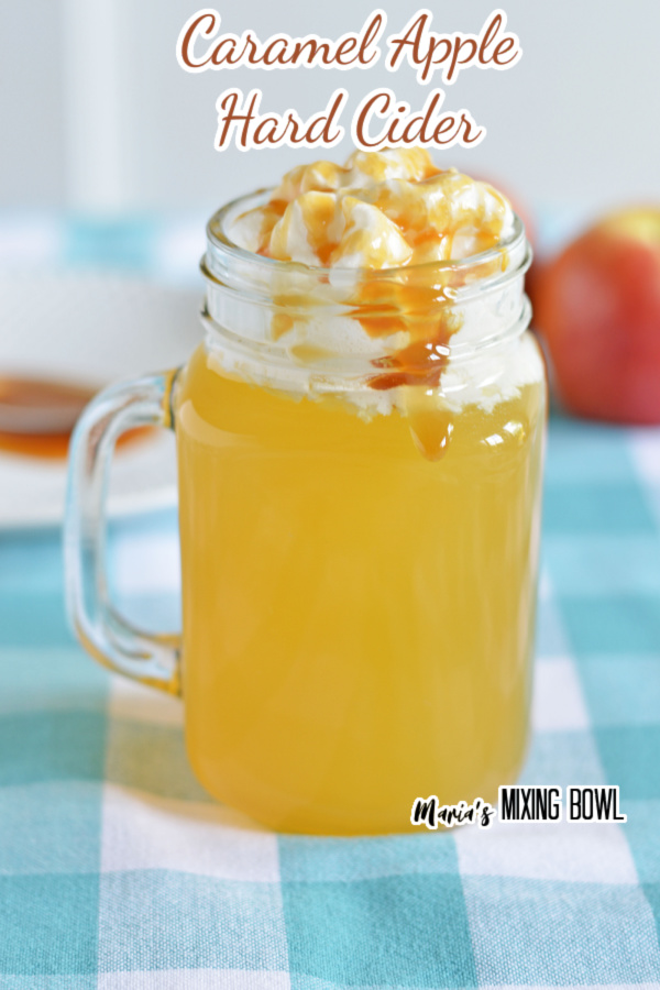 Caramel apple hard cider in mason jar mug on table