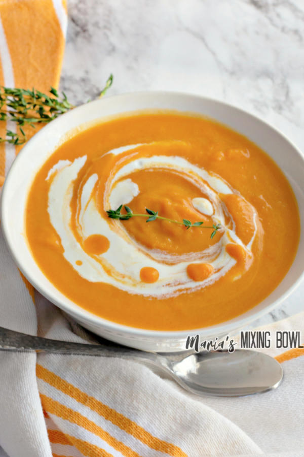 Bowlful of easy butternut squash soup with spoon sitting next to it